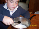 Adding the vinegar to the milk